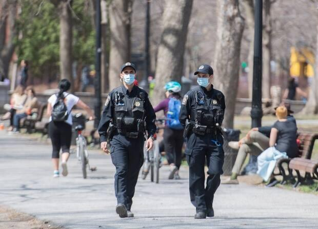 Some of the new mask rules appeared to be only irregularly followed last weekend, when parks across Montreal were jammed with people thanks to record-high temperatures. (Graham Hughes/The Canadian Press - image credit)