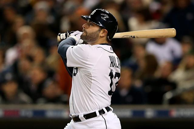 DETROIT, MI - OCTOBER 06: Alex Avila #13 of the Detroit Tigers hits a solo home run in the bottom of the fifth inning against the Oakland Athletics during Game One of the American League Division Series at Comerica Park on October 6, 2012 in Detroit, Michigan. (Photo by Leon Halip/Getty Images)