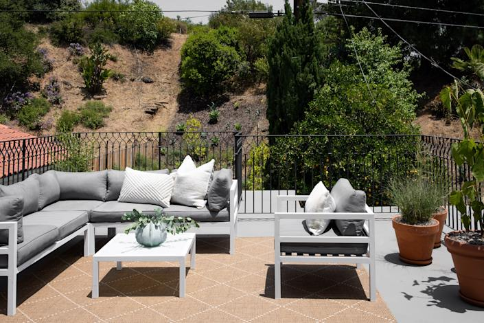 "<div class=""caption""> <strong>AFTER:</strong> The secluded <a href=""https://www.architecturaldigest.com/gallery/best-affordable-outdoor-furniture?mbid=synd_yahoo_rss"" rel=""nofollow noopener"" target=""_blank"" data-ylk=""slk:outdoor dining area"" class=""link rapid-noclick-resp"">outdoor dining area</a> is perfect for al fresco dining. </div>"