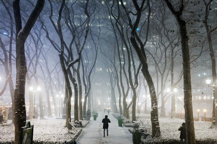 People walk through Manhattan in the first snowstorm of the season Dec. 16 in New York City.