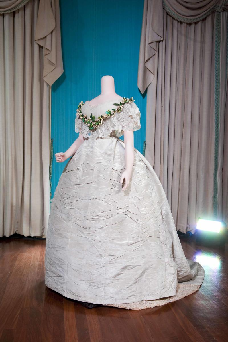 In this undated photo released by the Royal Collection on Thursday April 21 2011, this full-skirted white court dress made from English silk, lavishly decorated with Honiton lace was worn by Alexandra of Denmark when she married Albert Edward, Prince of Wales (later Edward VII and Queen Alexandra) in 1863. As speculation continues as to the design of Catherine Middleton's wedding dress, a precious collection of historic royal wedding dresses worn by royal brides over the last 200 years have just undergone over 1000 hours of conservation treatment by conservators from Britain's Historic Royal Palaces. The wedding dresses belonging to Princess Charlotte (1816), Queen Victoria (1840), Alexandra of Denmark (1863), Princess Mary of Teck (1893), Princess Margaret (1960) and Princess Alexandra of Kent (1963) are usually carefully stored at Kensington Palace but have been made available to the media and are viewable on the Historic Royal Palaces website. (AP Photo/The Royal Collection/Historic Royal Palaces) MANDATORY CREDIT.  NO ARCHIVE NO SALES.  SINGLE USE AND IN RELATION TO THE ROYAL WEDDING ONLY