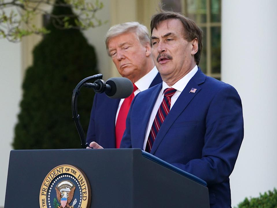US President Donald Trump listens as Michael J. Lindell, CEO of MyPillow Inc., speaks during the daily briefing on the novel coronavirus, Covid-19, in the Rose Garden of the White House in Washington, DC, on 30 March 2020 ((AFP via Getty Images))