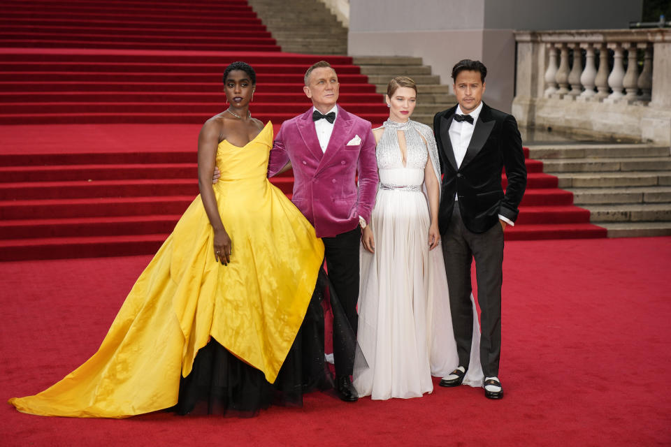 Lashana Lynch, from left, Daniel Craig, Lea Seydoux and Cary Joji Fukunaga pose for photographers upon arrival for the World premiere of the new film from the James Bond franchise 'No Time To Die', in London Tuesday, Sept. 28, 2021. (AP Photo/Matt Dunham)