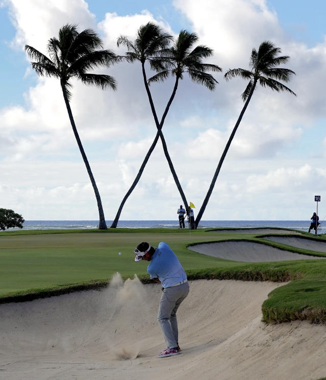 Bubba Watson hits out of the bunker on the 16th green during the first round of the Sony Open PGA Tour golf event, Thursday, Jan. 10, 2019, at the Waialae Country Club in Honolulu, Hawaii. (AP Photo/Matt York)