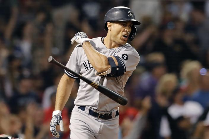 New York Yankees' Giancarlo Stanton tosses his bat after hitting a grand slam during the eighth inning of a baseball game against the Boston Red Sox, Saturday, Sept. 25, 2021, in Boston. (AP Photo/Michael Dwyer)