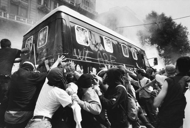 GENOA, ITALY - JULY:  (FRANCE OUT)   Protesters attack an Italian police vehicle during protests against the 27th Group of Eight Summit in July, 2001 in Genoa, Italy. Hundreds of thousands of protesters gathered between July 18 and 22 in Genoa to participate in demonstrations against the meeting of the G8 nations. Ensuing clashes with police resulted in many injuries, arrests and the death of 23-year-old demonstrator Carlo Giuliani on July 20, 2001.  (Photo by Paul BLACKMORE/RAPHO/Gamma-Rapho via Getty Images) (Photo: Paul BLACKMORE via Getty Images)