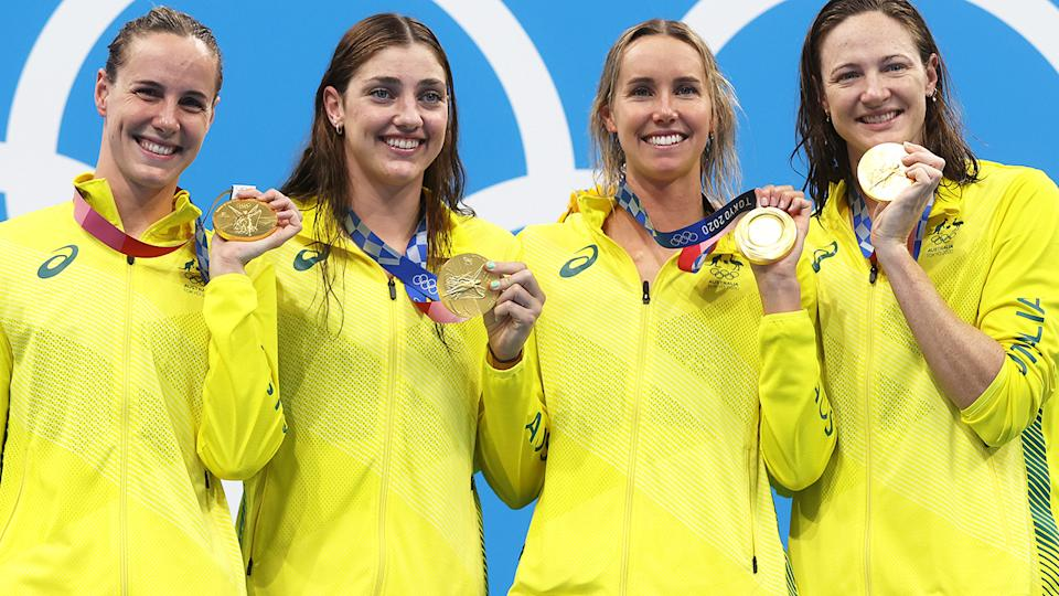 Bronte Campbell, Meg Harris, Emma McKeon and Cate Campbell of Team Australia pose after winning the gold medal in the Women's 4 x 100m Freestyle Relay Final at the Tokyo Olympics. (Photo by Clive Rose/Getty Images)
