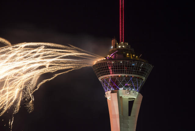 <p>A fireworks display goes from the observation tower at the Stratosphere in Las Vegas on Wednesday, July 4, 2018. (Photo: Richard Brian/Las Vegas Review-Journal via AP) </p>