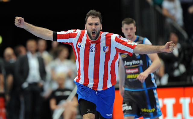 Madrid's Joan Canellas celebrates after scoring against Copenhagen during the Handball Champions League EHF Final Four semi final match BM Atletico Madrid vs AG Kobenhavn on May 26, 2012 in Cologne, western Germany. Madrid won the match 25-23. AFP PHOTO JONAS GUETTLER GERMANY OUTJONAS GUETTLER/AFP/GettyImages