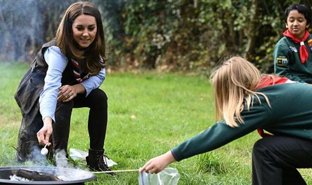 Duchess of Cambridge wears Scout scarf and toasts marshmallows as she takes on new role