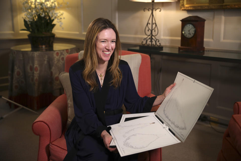 LONDON, UNITED KINGDOM - MAY 20:  Clare Waight Keller, designer at Givenchy, holds sketches as she gives an interview the day after the Duchess of Sussex  walked down the aisle of St George's Chapel in Windsor and married Prince Harry, Duke of Sussex  wearing the dress that she created, in Kensington Palace on May 20, 2018 in London, United Kingdom. (Photo by Hannah McKay - WPA Pool/Getty Images)