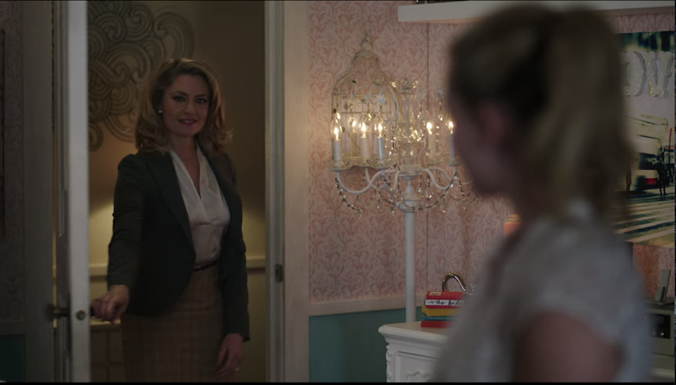 Betty's room has a standing chandelier