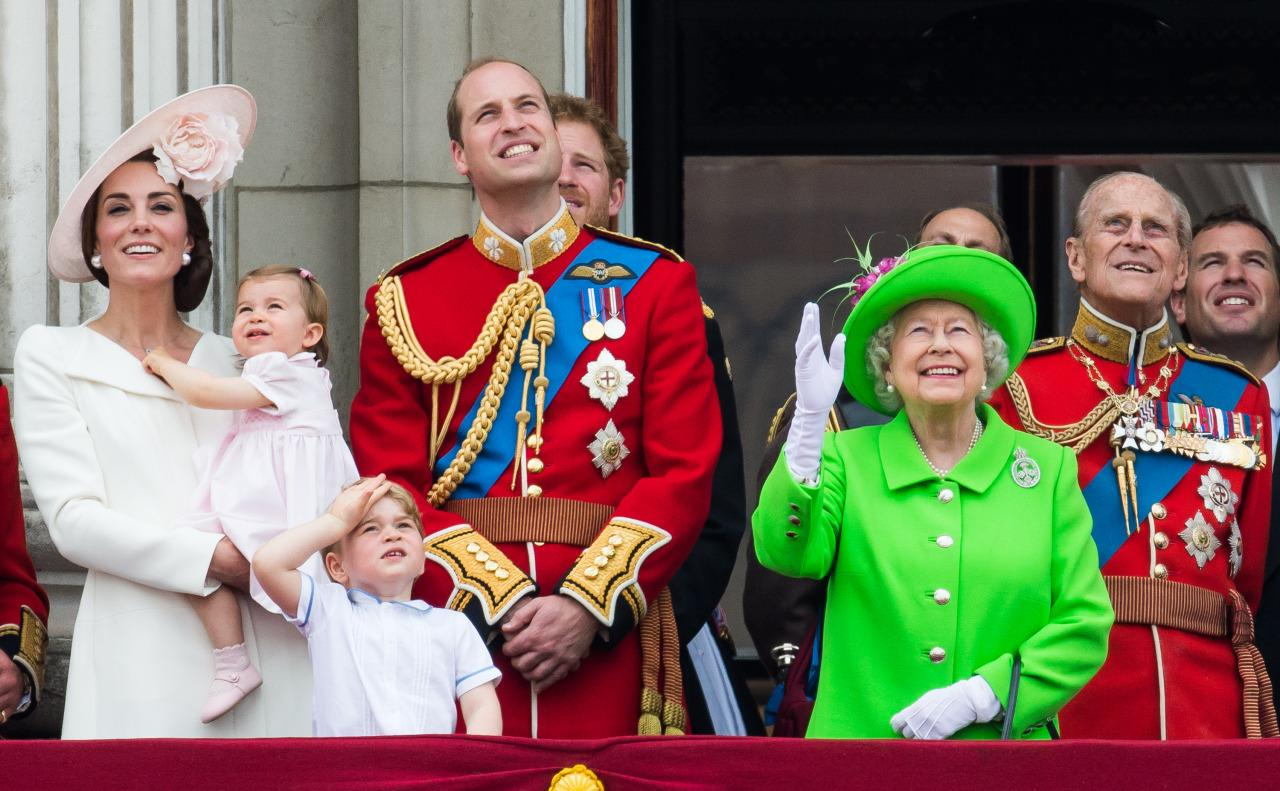 """<p>For the annual <a rel=""""nofollow"""" href=""""https://uk.style.yahoo.com/five-years-trooping-the-colour-the-duchess-of-162359830.html"""">Trooping the Colour</a> parade, the Duchess of Cambridge opted for a neutral color palate and wore a white coat dress, the same Alexander McQueen number she wore for Princess Charlotte's christening. She paired the sophisticated piece with a fun fascinator from famed milliner Philip Treacy that featured a large pink flower and had her hair styled in a side chignon.<i>(Photo: Getty Images)</i></p>"""