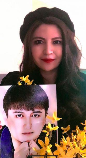 PHOTO: Rayhan Asat pictured here with a photo of her incarcerated brother, Ekpar Asat. He may face 15 years in a Chinese prison on vague charges.  (Rayhan Asat)