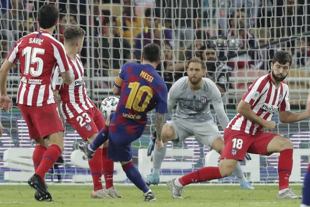 Barcelona's Lionel Messi scored in the 3-2 defeat to Atletico Madrid in the Spanish Super Cup (Hassan Ammar/AP)