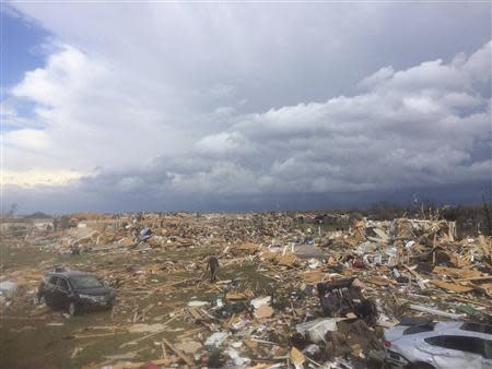 Extensive damage is pictured in the aftermath of a tornado that touched down in Washington, Illinois on November 17, 2013 in this photo courtesy of Anthony Khoury. REUTERS/Anthony Khoury/Handout