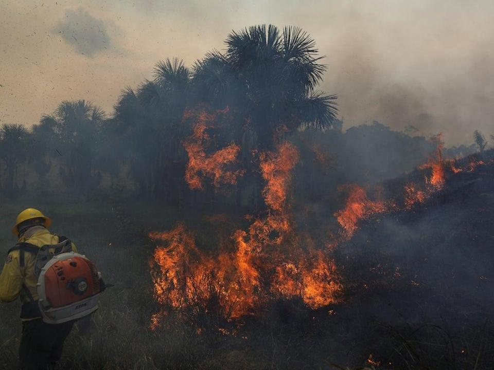 Fire crews attempting to tackle a fire in Apui, Amazonas state, Brazil, on 5 September (REUTERS)