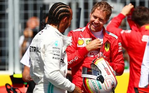 Pole position qualifier Sebastian Vettel of Germany and Ferrari and second place qualifier Lewis Hamilton of Great Britain and Mercedes GP talk in parc ferme during qualifying for the F1 Grand Prix of Canada at Circuit Gilles Villeneuve on June 08, 2019 in Montreal, Canad - Credit: Getty Images