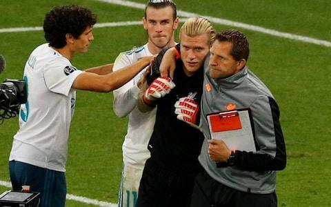 <span>Bale tries to console a distraught Karius at the end</span> <span>Credit: PHIL NOBLE/REUTERS </span>