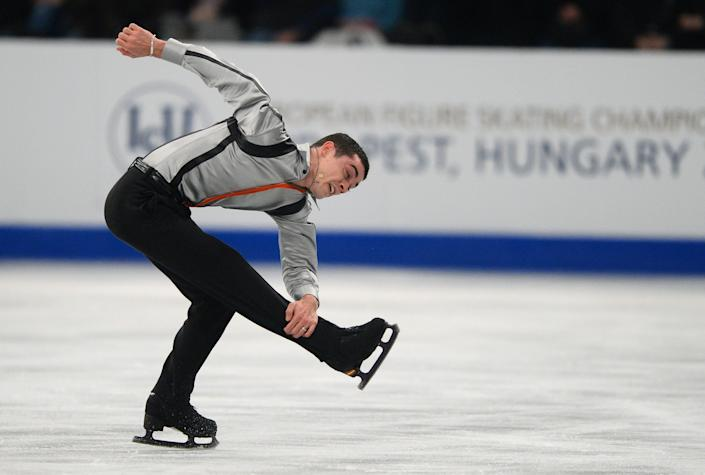 Spain's Javier Fernandez performs on ice at the 'SYMA' sports hall in Budapest, Hungary on January 18, 2014 during the men's free skating program of the ISU European Figure Skating Championships. (ATTILA KISBENEDEK/AFP/Getty Images)