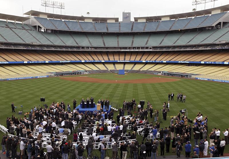 New Los Angeles Dodgers owners and Guggenheim Baseball Management partners hold a news conference at Dodger Stadium in Los Angeles, Wednesday, May 2, 2012. The franchise's prestige and fan support declined during the stormy ownership tenure of Frank McCourt, who sold the Dodgers for $2 billion to the group fronted by Magic Johnson, headed by Mark Walter and run by Stan Kasten. (AP Photo/Damian Dovarganes)
