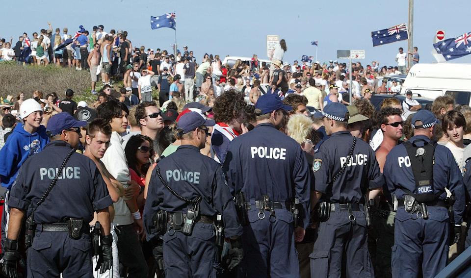 Police officers surround a group of people during the Cronulla Riots in 2015.