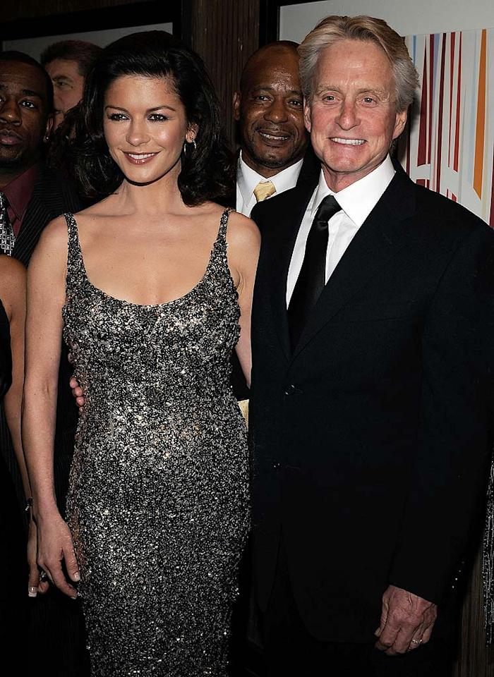 "The eternally youthful Catherine Zeta-Jones arrives with husband Michael Douglas. Looks like Michael may need some hair coloring tips from his wife! Larry Busacca/<a href=""http://www.wireimage.com"" target=""new"">WireImage.com</a> - May 17, 2008"