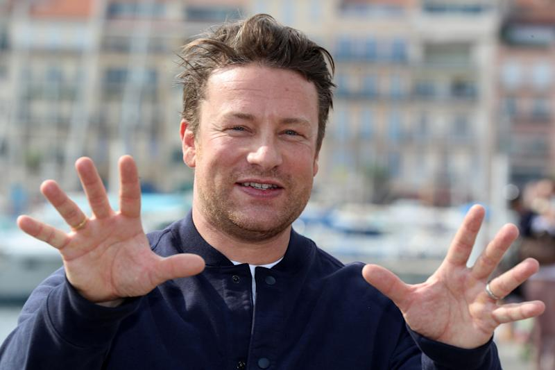 "British chef and activist Jamie Oliver, poses during a photocall for a TV serie ""Jamie Oliver"" as part of the MIPCOM, the world's biggest television and entertainment market, on October 15, 2018 in Cannes, southeastern France. (Photo by VALERY HACHE / AFP) (Photo credit should read VALERY HACHE/AFP/Getty Images)"