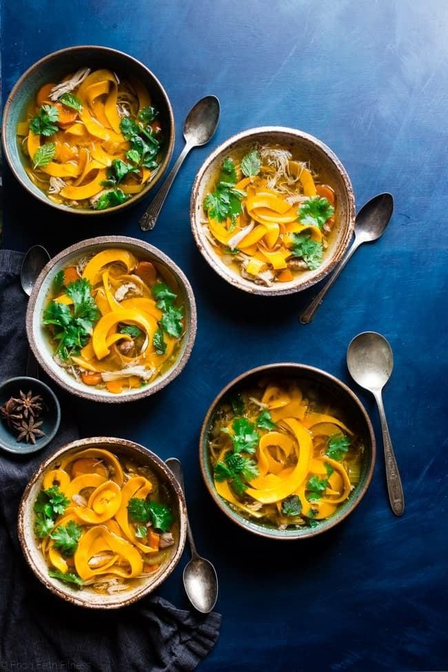 """<p>Both gluten and grain-free, this recipe is perfect for a cold rainy night. Sip on this Thai inspired soup using butternut squash as noodles. </p> <p><strong>Get the recipe: </strong><a href=""""http://www.foodfaithfitness.com/thai-crock-pot-chicken-noodle-soup/"""" class=""""link rapid-noclick-resp"""" rel=""""nofollow noopener"""" target=""""_blank"""" data-ylk=""""slk:Thai slow-cooker paleo chicken noodle soup"""">Thai slow-cooker paleo chicken noodle soup</a></p>"""