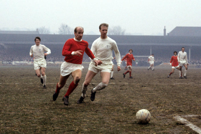 Leeds United's Jack Charlton, right, challenges his brother Manchester United's Bobby Charlton (Picture: PA)