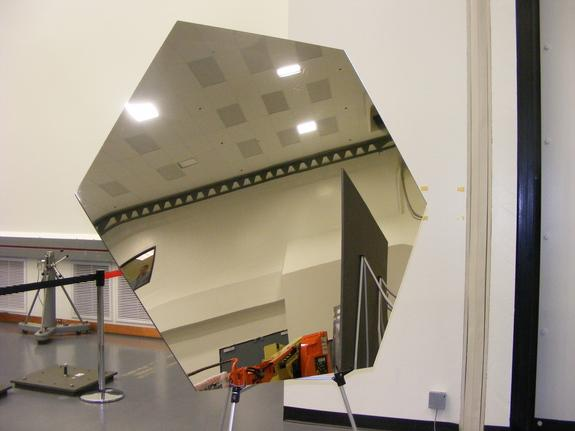 An example of one of the eighteen hexagonal mirrors that JWST will carry. The final mirrors will have a thin coat of gold to increase their reflectiveness.