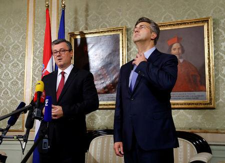 Croatia's new Prime Minister Andrej Plenkovic (R) is pictured next to former Prime Minister Tihomir Oreskovic in the government building in Zagreb, October 19, 2016. REUTERS/Antonio Bronic