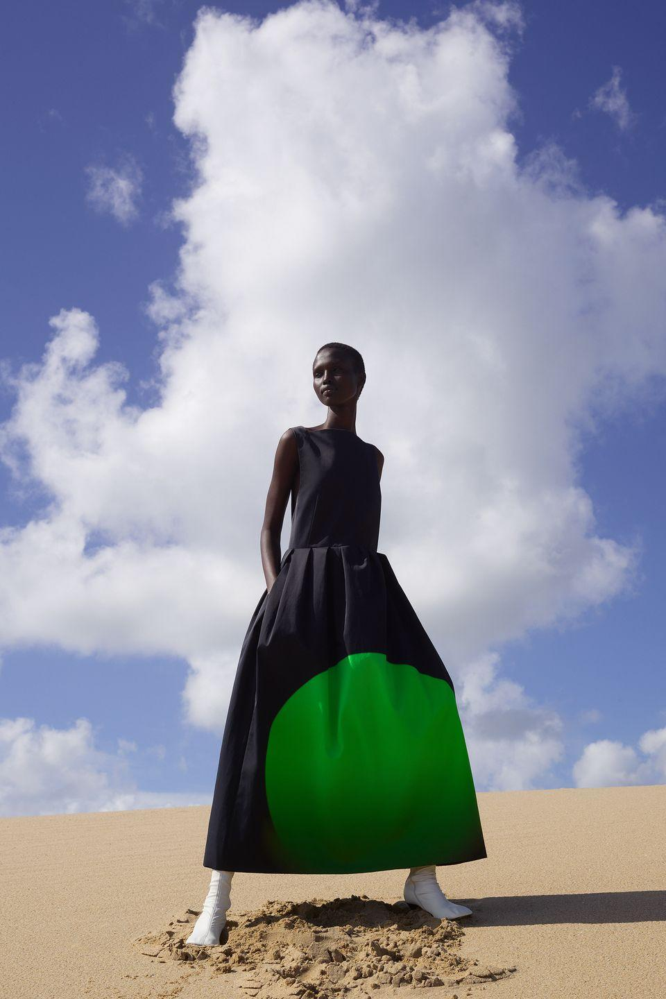 "<p>The Dutch lockdown last spring found designer Dries Van Noten asking big questions: What's going to be important in the future? Is there still going to <em>be</em> fashion in the future? The answer, according to the spring 2021 look book he shot on a beach in Rotterdam with artist Viviane Sassen, is a resounding yes. ""I wanted really to make something that was 'fashion optimistic,'"" he said. That motive translated into a vivid profusion of mood-lifting color; gone were the usual heavy heritage jacquards in favor of floating cotton organzas. Van Noten drew inspiration from the color-drenched experimental films of Len Lye, an early 20th-century artist who painted directly on celluloid, decades before the psychedelic movement. What appeared as simple stripes on balloon-sleeve dresses, belted coats, and bathing suits (a first for the brand) were, in fact, shards of light cast through a louver shutter, captured, and printed. Van Noten put it best: ""The total look of the collection looks more simple but it's more in depth."" <em>—Alison S. Cohn</em></p>"