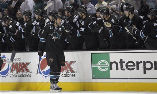 San Jose Sharks center Joe Thornton (19) celebrates with teammates after scoring a goal against the Dallas Stars during the second period of an NHL hockey game in San Jose, Calif., Thursday, Feb. 2, 2012. (AP Photo/Tony Avelar)