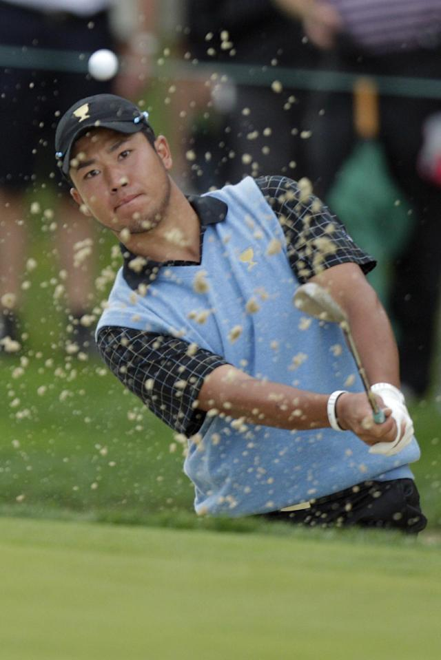International team player Hideki Matsuyama, of Japan, hits out of a bunker on the first hole during the single matches at the Presidents Cup golf tournament at Muirfield Village Golf Club Sunday, Oct. 6, 2013, in Dublin, Ohio. (AP Photo/Jay LaPrete)