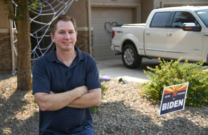"""Josh Heaton, a life-long conservative who voted for Donald Trump in 2016 and """"immediately"""" regretted it, poses for a portrait outside his home in Phoenix, Arizona on October 16, 2020"""