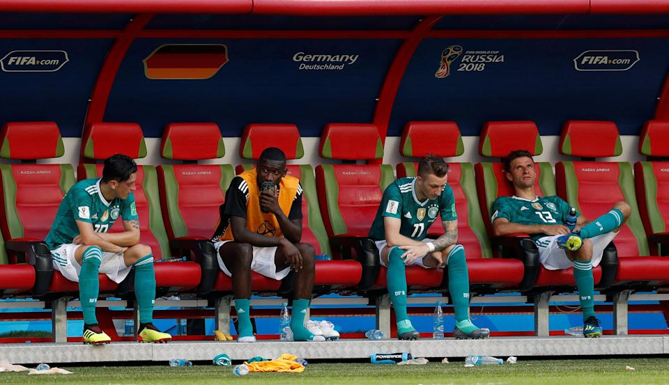 <p>Germany's Mesut Ozil, Antonio Rudiger, Marco Reus and Thomas Muller look dejected after the match as they go out of the World Cup. REUTERS/John Sibley </p>