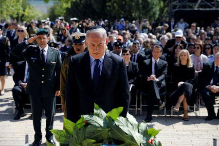 Israeli Prime Minister Benjamin Netanyahu lays a wreath during a ceremony marking the annual Holocaust Remembrance Day at the Yad Vashem Holocaust memorial, in Jerusalem