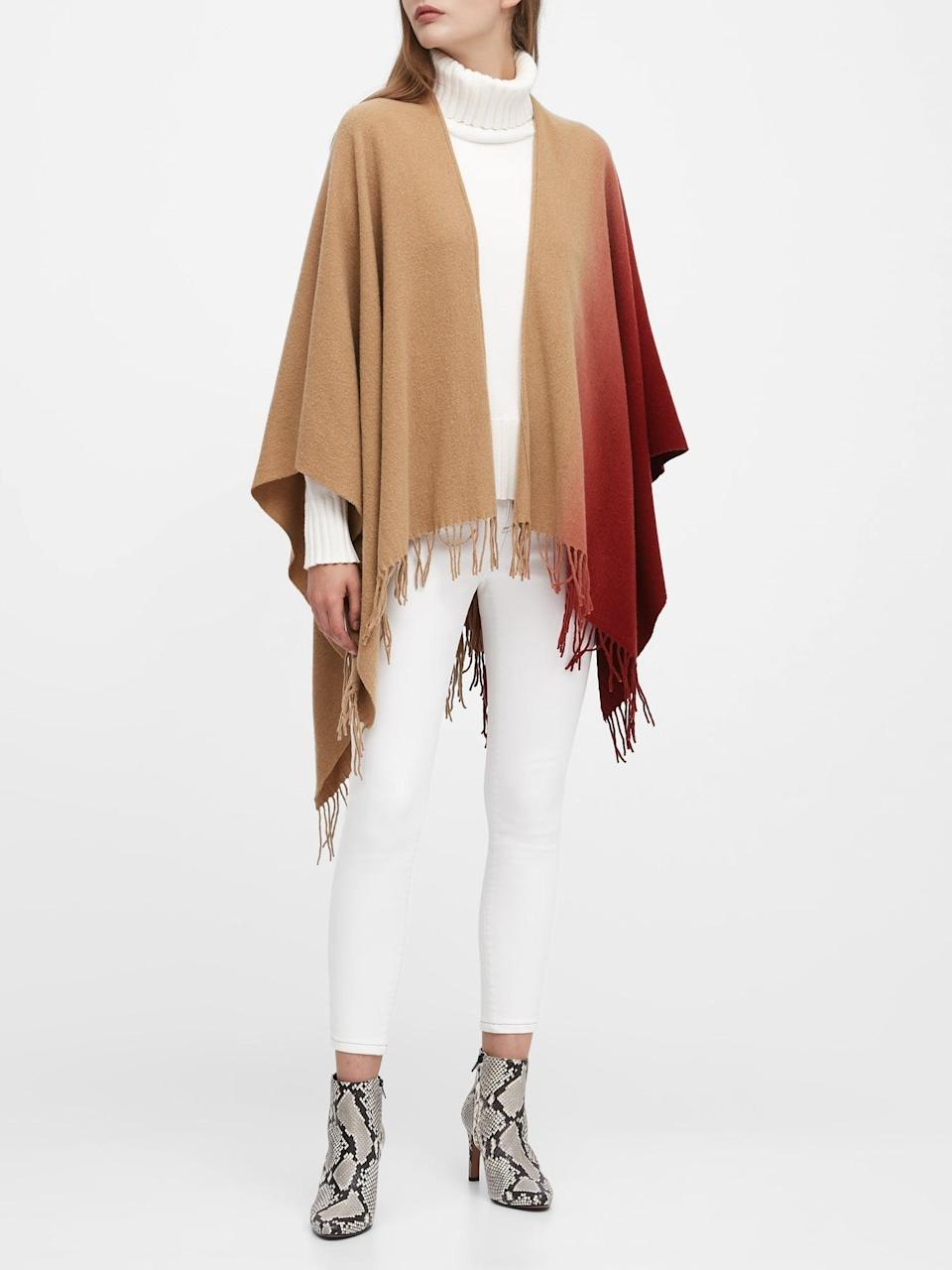 "<p>We love the style of this <a href=""https://www.popsugar.com/buy/Banana-Republic-Ombr%C3%A9-Wool-Blend-Poncho-528415?p_name=Banana%20Republic%20Ombr%C3%A9%20Wool-Blend%20Poncho&retailer=bananarepublic.gap.com&pid=528415&price=118&evar1=fab%3Aus&evar9=36291197&evar98=https%3A%2F%2Fwww.popsugar.com%2Fphoto-gallery%2F36291197%2Fimage%2F46988974%2FBanana-Republic-Ombr%C3%A9-Wool-Blend-Poncho&list1=shopping%2Choliday%2Cwinter%2Cgift%20guide%2Cwinter%20fashion%2Choliday%20fashion%2Cfashion%20gifts&prop13=api&pdata=1"" rel=""nofollow noopener"" class=""link rapid-noclick-resp"" target=""_blank"" data-ylk=""slk:Banana Republic Ombré Wool-Blend Poncho"">Banana Republic Ombré Wool-Blend Poncho</a> ($118).</p>"