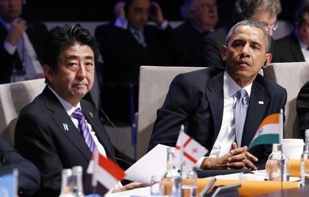 U.S. President Obama and Japan's PM Abe attend the opening session of the Nuclear Security summit in The Hague