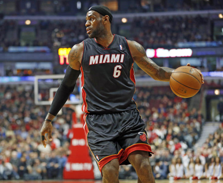 Miami Heat forward LeBron James looks to pass the ball against the Chicago Bulls during the first half of an NBA basketball game in Chicago, Thursday, Dec. 5, 2013. (AP Photo/Kamil Krzaczynski)