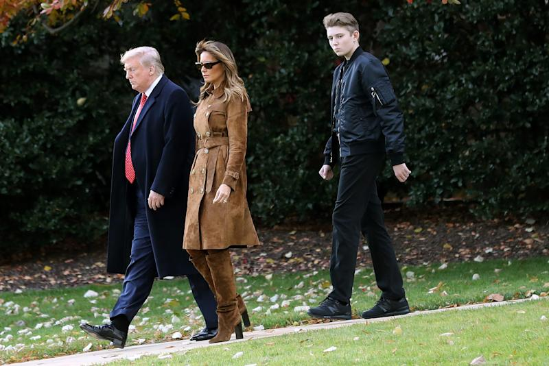 President Donald Trump, first lady Melania Trump and Barron Trump, 13, who towers over his parents, walk across the South Lawn to Marine One on Nov. 26, 2019, on their way to Florida for Thanksgiving.