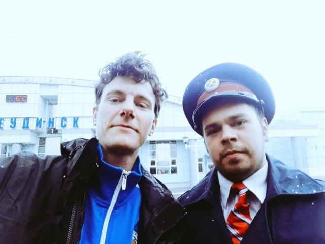 The author of this story, Roger Tyers, meeting a train guard in Siberia