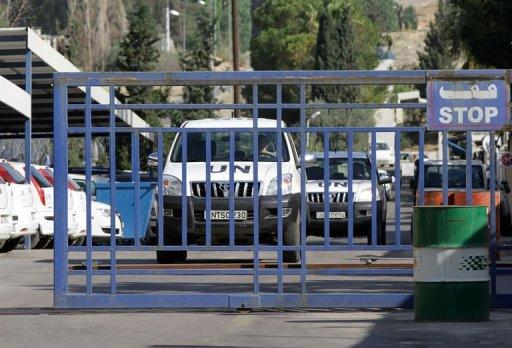 A United Nations monitors convoy leaves the UN headquarters in Damascus