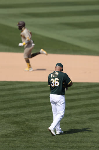 San Diego Padres' Fernando Tatis Jr rounds the bases after hitting a solo home run against the Oakland Athletics' Yusmeiro Petit during the seventh inning of a baseball game in Oakland, Calif., Sunday, Sept. 6, 2020. (AP Photo/Jed Jacobsohn)