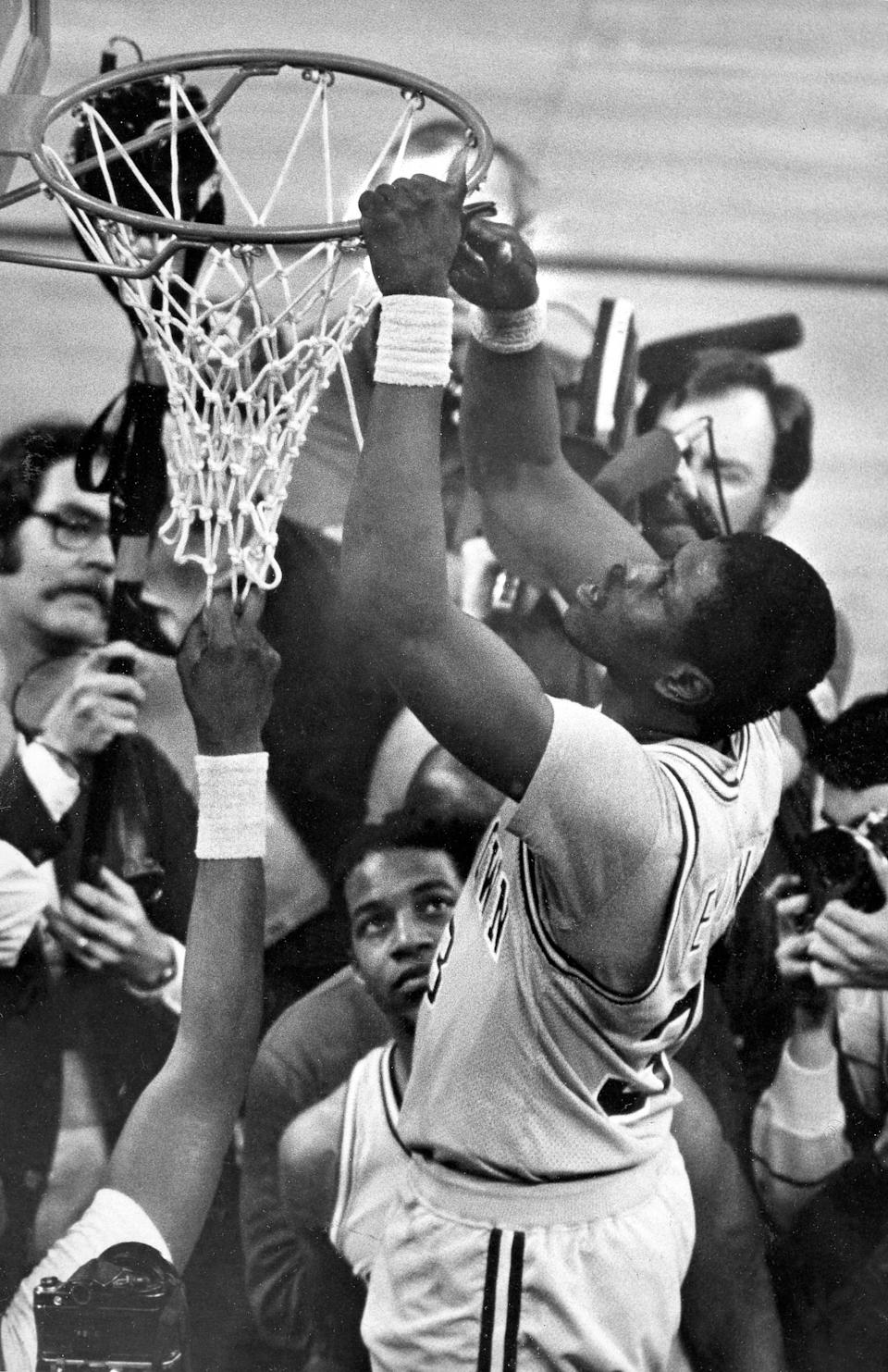 FILE - Georgetown's Patrick Ewing cuts his share of the net after Georgetown beat Houston for the NCAA college basketball national championship in Seattle, in this April 3, 1984, file photo. Patrick Ewing and Georgetown are back in the NCAA Tournament. The 7-footer who helped the Hoyas win one national championship and reach two other finals in the 1980s is now coaching at his alma mater. Georgetown is a No. 12 seed and will play No. 5 Colorado in the East Region on Saturday, March 20, 2021. (AP Photo/File)