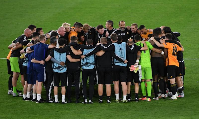 Wolves players and staff huddle after progress to Germany was secured.