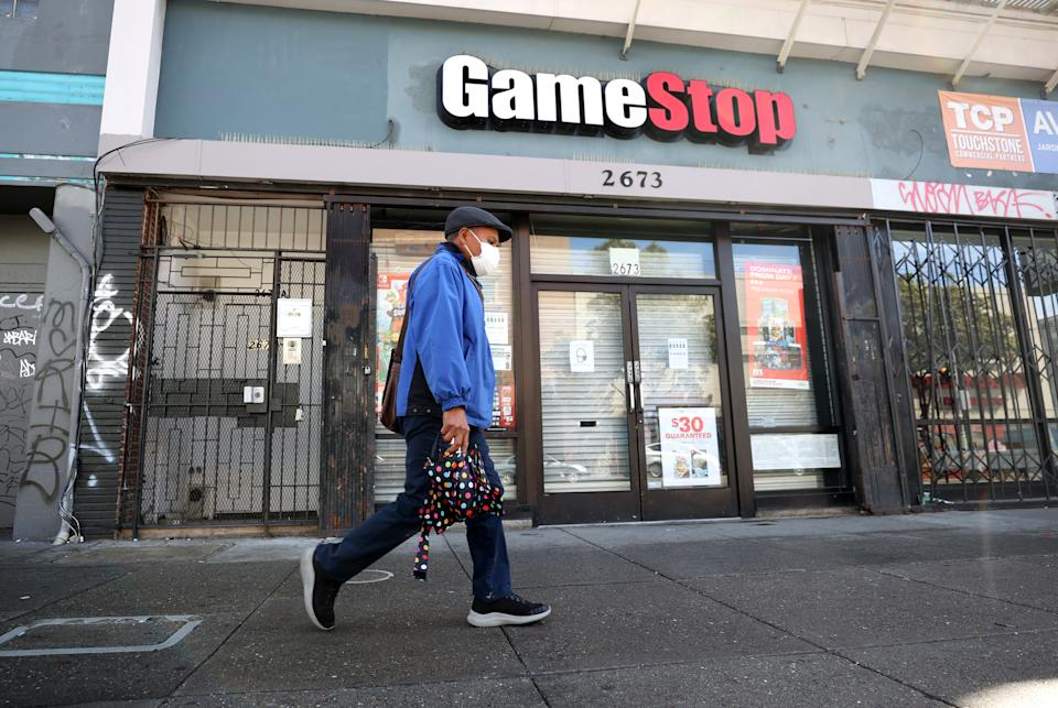 SAN FRANCISCO, CALIFORNIA - MARCH 10: A pedestrian walks by a GameStop store on March 10, 2021 in San Francisco, California. Trading of GameStop shares was halted several times on Wednesday due to volatility after the stock surged to a record high of $348.50 per share before falling to below $200 per share. The stock closed at $265 per share. (Photo by Justin Sullivan/Getty Images)