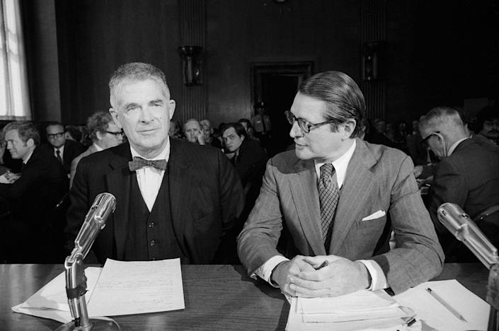 """<p>Attorney General designate Elliot Richardson, right, introduced Archibald Cox, former solicitor general, to the Senate Judiciary Committee on May 21, 1973. Cox, left, told speakers that Richardson had given him """"all the power needed to be independent"""" in his job as special Watergate prosecutor. (Photo: Bettmann/Getty Images) </p>"""