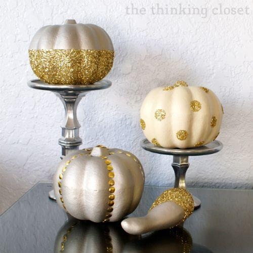 "<p>When is glitter<em> not</em> a good idea? These tiny pumpkins positively sparkle with a splash of metallic gold. </p><p><em><a href=""http://www.thinkingcloset.com/2013/10/28/glitter-glam-pumpkins-100-gift-card-giveaway/"" rel=""nofollow noopener"" target=""_blank"" data-ylk=""slk:Get the tutorial at The Thinking Closet »"" class=""link rapid-noclick-resp"">Get the tutorial at The Thinking Closet »</a></em></p>"